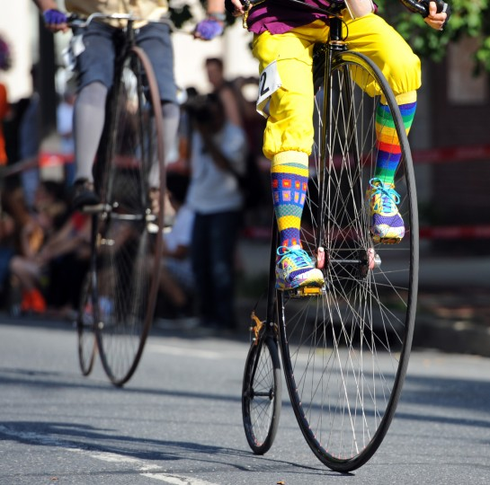 A rider sports a colorful outfit in the 2014 Frederick Clustered Spires High Wheel Race. (Kim Hairston/Baltimore Sun)