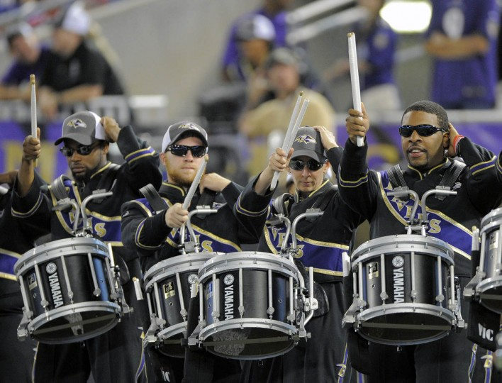 Baltimore's Marching Ravens dance as they perform as the Baltimore Ravens take on the San Francisco 49ers at M&T Bank Stadium in Baltimore, MD on Thursday, August 7, 2014. (Al Drago/Baltimore Sun)