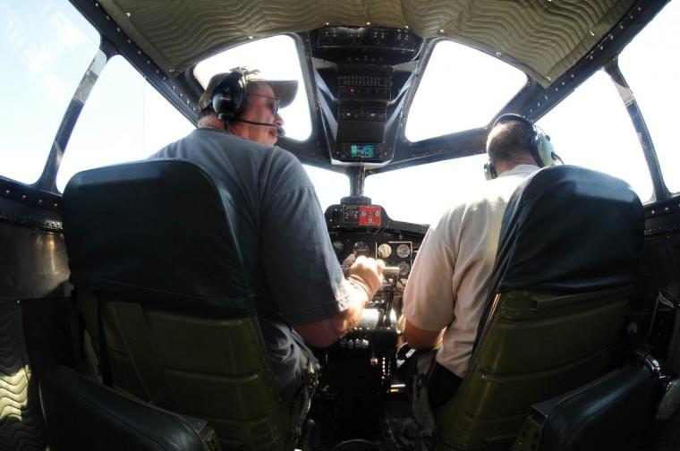 Pilot Bob Hill from Nashville, TN, left, and co-pilot John Shuttleworth from Huntington, IN, fly the Boeing B-17. (Algerina Perna/Baltimore Sun)