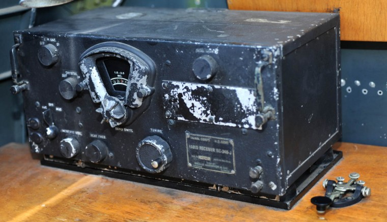 A radio receiver sits on a table just outside the bomb bay. The telegraph key next to it was used to send Morse Code to communications on the ground and to other airplanes in the group. (Algerina Perna/Baltimore Sun)