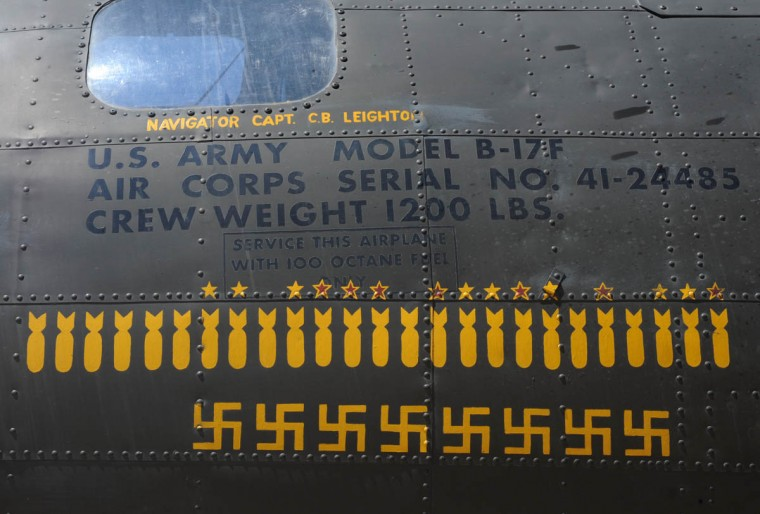 """The side of the aircraft, The Movie Memphis Belle,"""" has the same designs used on the original plane which fought 25 missions in WWII. Each bomb drawing represents one mission. Each Swastika represents a German fighter that was shot down by a crew member. (Algerina Perna/Baltimore Sun)"""