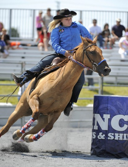 Amber Goff of Westminster High School rounds the final barrel in the barrel racing event. (Lloyd Fox/Baltimore Sun)