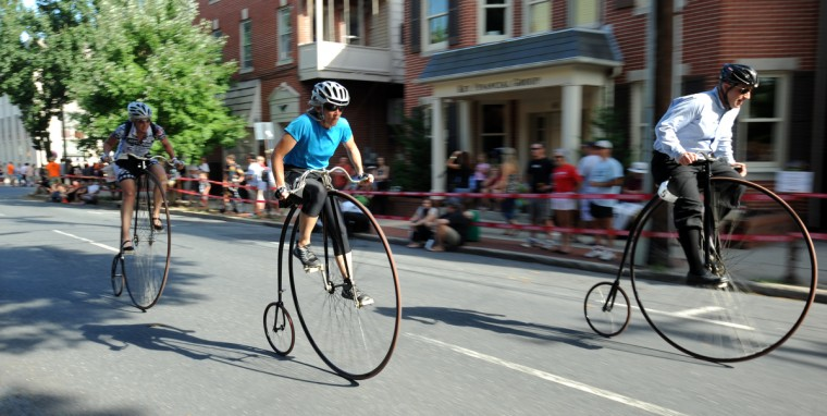 From left, Angela Long of West Friendship, Lori Woodward of Merrimack, N.H., and Haig Colter of Bethesda race their penny farthings in the 2014 Frederick Clustered Spires High Wheel Race. (Kim Hairston/Baltimore Sun)