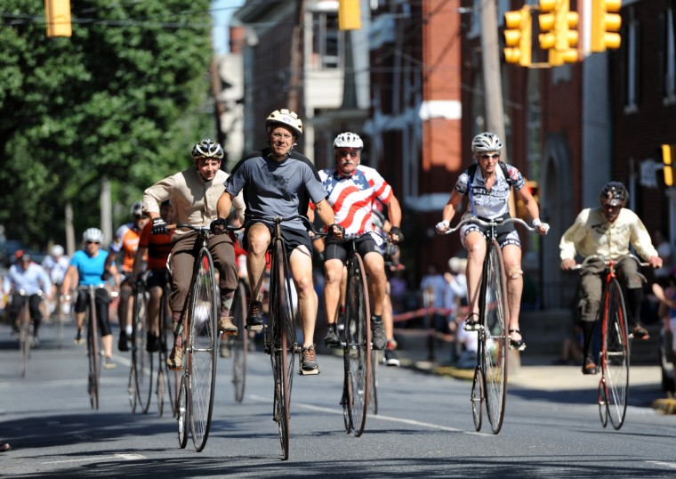 "Riders in the 2014 Frederick Clustered Spires High Wheel Race. Billed as the ""only high wheel race of its kind in America,"" the event is held in historic downtown Frederick. (Kim Hairston/Baltimore Sun)"