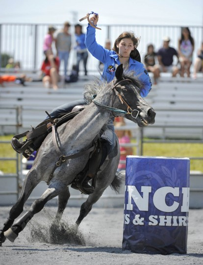 Taylor Branan of Choptican H.S. heads around the last barrel during the barrel racing competition. (Lloyd Fox/Baltimore Sun)