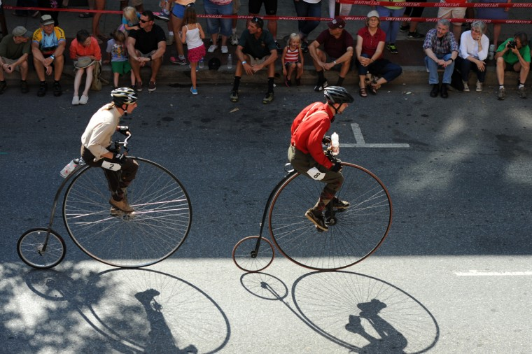 From left, Steve Weddles of Greencastle, Pa., rides a 2014 Nutter-CZ Phase I, and Brian Caron of Hagerstown rides a 1882 Expert Columbia, pedal the course along N. Market Street. (Kim Hairston/Baltimore Sun)