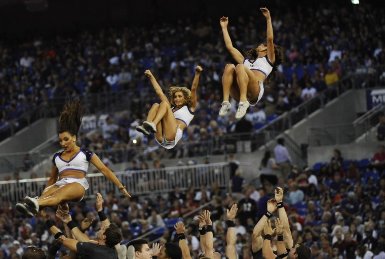 Ravens cheerleaders fly in the air during the game against the San Francisco 49ers at M&T Bank Stadium on August 7, 2014. The Ravens won 23-3. (Rachel Woolf/Baltimore Sun)