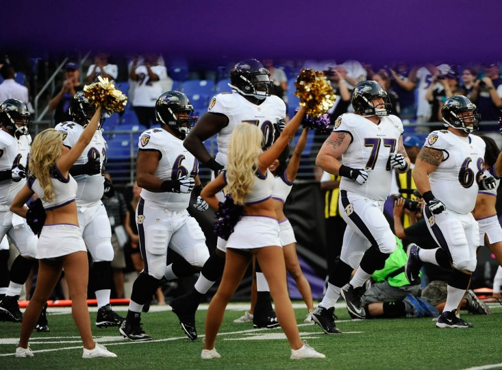 The Baltimore Ravens run into the stadium before the game quarter against the San Francisco 49ers at M&T Bank Stadium on August 7, 2014. (Rachel Woolf/Baltimore Sun)