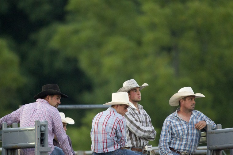 Cowboys wait during the Bull Blast at the 69th Annual Howard County Fair in West Friendship, on Monday, August 4, 2014. (Jen Rynda/BSMG)