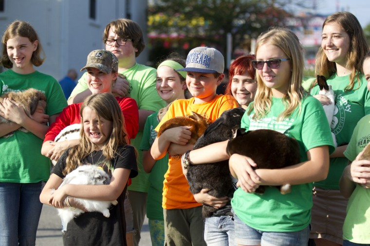 A group of 4-H members gather for a photo before a rabbit presentation outside of the agriculture education tent. (Jen Rynda/BSMG)