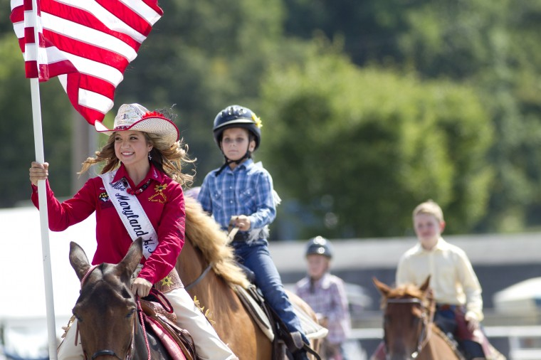 Miss Maryland High School Rodeo Queen Madison Iager, 15, of Woodbine leads a group of participants during the opening of the Maryland High School Rodeo. (Jen Rynda/BSMG)