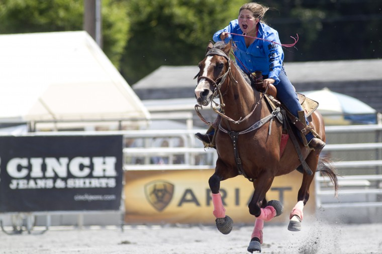 Darby Conrad, 12, of Lancaster, Pa., gets her horse, Stroker Ace, to run harder during the barrel race competition of the Maryland High School Rodeo. (Jen Rynda/BSMG)