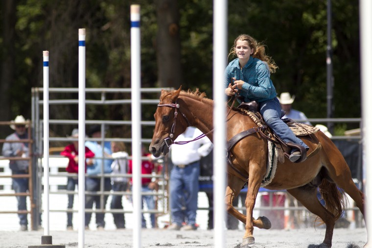Pole bending at the Maryland High School Rodeo during the Howard County Fair on Thursday, August 7. (Jen Rynda/BSMG)