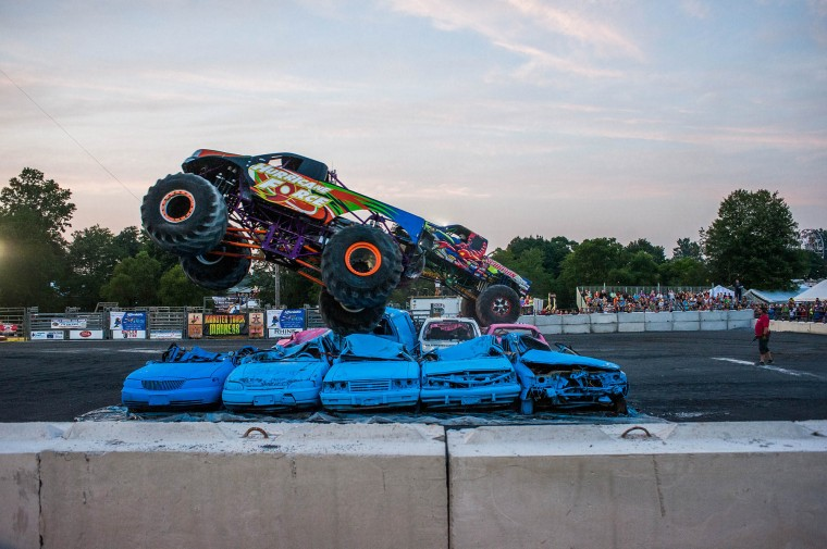Monster trucks take off into the air during the monster truck races at the Howard County Fair on Wednesday, August 6. (Noah Scialom/BSMG)