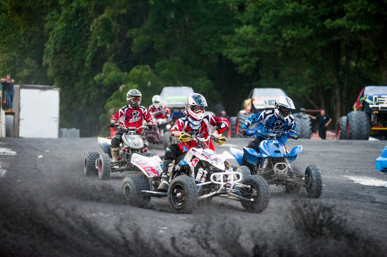 Quad racers circle the track during the monster truck races at the Howard County Fair on Wednesday, August 6. (Noah Scialom/BSMG)