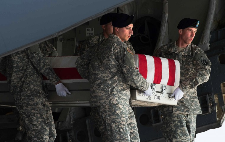 A U.S. Army detail carries a transfer case with the body of Major General Harold Greene during a dignified transfer at the Dover Air Force Base in Dover, Delaware, August 7, 2014. Greene was the most senior U.S. military official killed in action overseas since the war in Vietnam. (Jason Minto/Reuters)