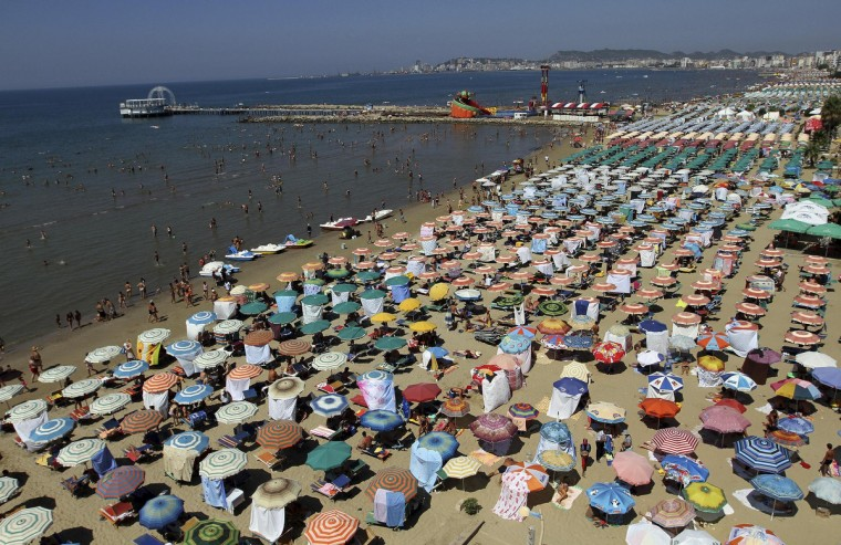 A general view of the crowded beach is seen in the city of Durres. Albania has been gripped by hot weather with temperatures reaching 38 degrees Celsius (100 degrees Fahrenheit). (Arben Celi/Reuters)
