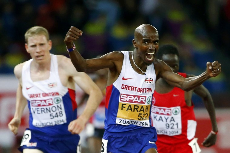 Mohamed Farah of Britain (C) celebrates winning in front of compatriot Andy Vernon (L) and Ali Kaya of Turkey (R) in the men's 10000 metres final during the European Athletics Championships at the Letzigrund Stadium in Zurich. (Arnd Wiegmann/Reuters)