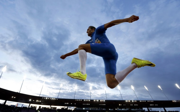 Fabrizio Donato of Italy competes in the men's triple jump final during the European Athletics Championships at the Letzigrund Stadium in Zurich August 14, 2014. (Phil Noble/Reuters)