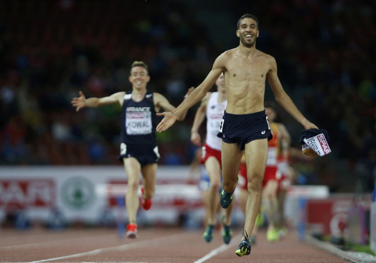 Mahiedine Mekhissi-Benabbad of France crosses the finish line with his vest in his hand, to win the men's 3000 metres steeplechase final during the European Athletics Championships at the Letzigrund Stadium in Zurich August 14, 2014. (Arnd Wiegmann/Reuters)