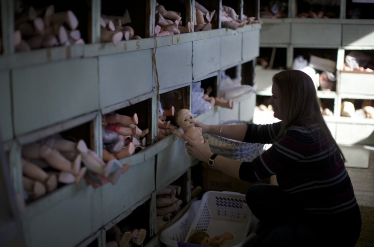 Doll repairer Tamara Ottessen searches for replacement limbs on a customer's doll in the workshop of Sydney's Doll Hospital. (Jason Reed/Reuters)