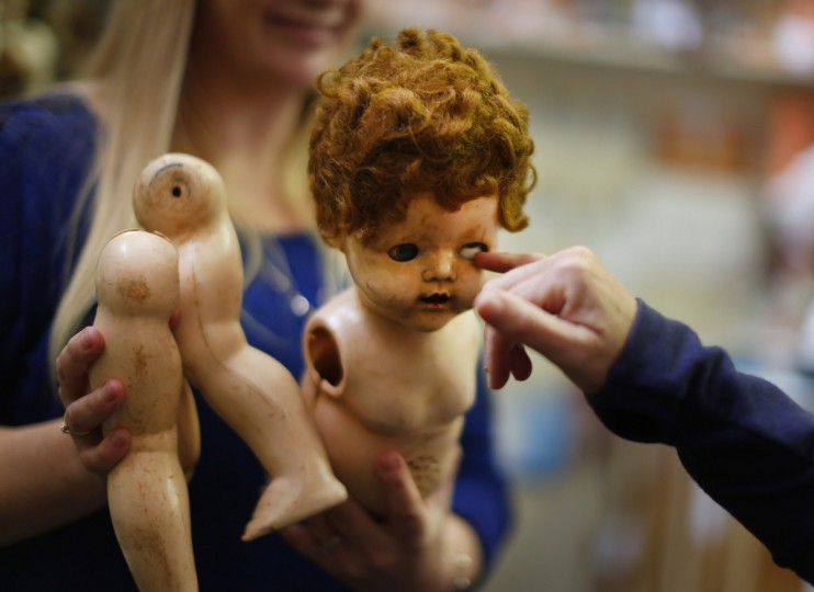 A damaged doll is brought in for repair by a customer at Sydney's Doll Hospital. (Jason Reed/Reuters)
