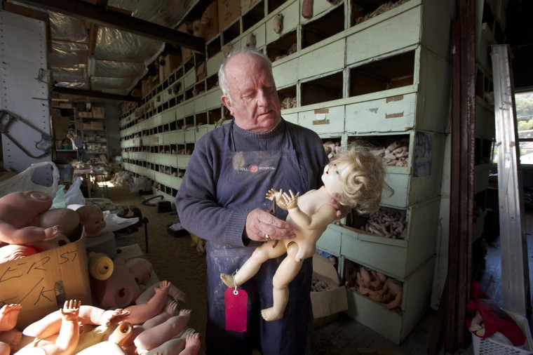 Geoff Chapman, 'Head Surgeon' at Sydney's Doll Hospital, is pictured in his workshop. (Jason Reed/Reuters)