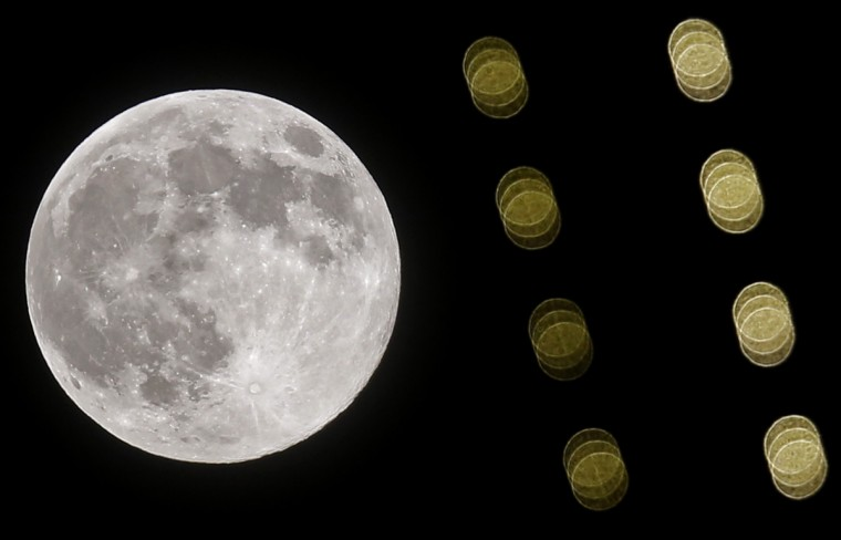 The supermoon is seen behind lights hanging on a minaret of a mosque in the central Bosnian town of Zenica, August 10, 2014. The astronomical event occurs when the moon is closest to the Earth in its orbit, making it appear much larger and brighter than usual. (Dado Ruvic/Reuters)