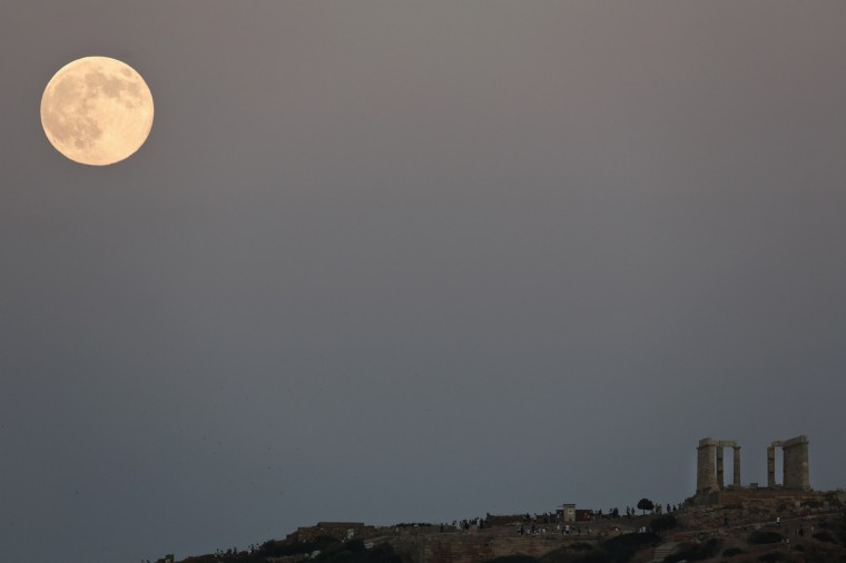 The supermoon rises over the Temple of Poseidon, the ancient Greek god of the seas, in Cape Sounion, east of Athens August 10, 2014. The astronomical event occurs when the moon is closest to the Earth in its orbit, making it appear much larger and brighter than usual. (Yorgos Karahalis/Reuters)