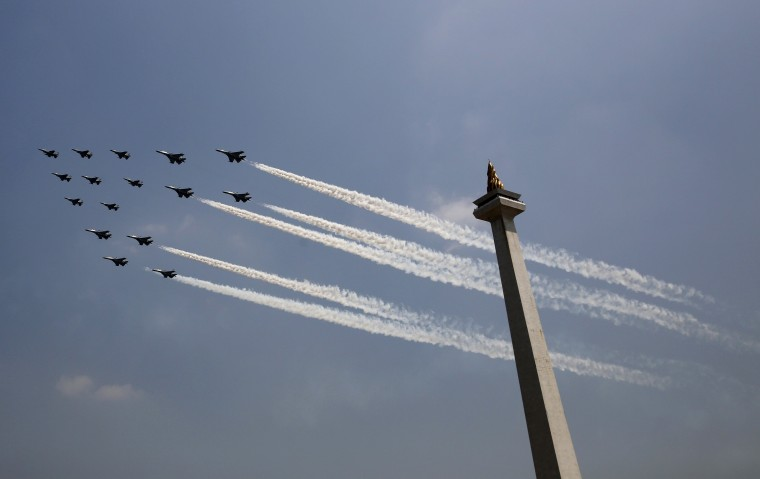 Indonesian Air Force planes fly past the National Monument to mark the country's 69th Independence Day celebration in Jakarta August 17, 2014. (Darren Whiteside/Reuters)