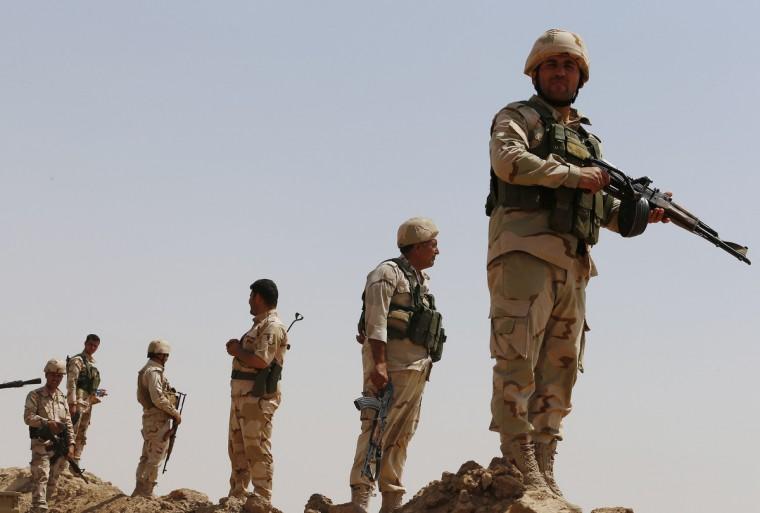 Kurdish Peshmerga forces stand guard at the Bakirta frontline near the town of Makhmur, south of Erbil, the capital of Iraqi Kurdistan. (Youssef Boudlal/Reuters)