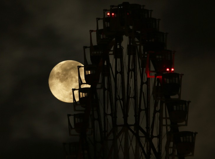 The supermoon is seen behind a ferris wheel in Tokyo August 11, 2014. The astronomical event occurs when the moon is closest to the Earth in its orbit, making it appear much larger and brighter than usual. (Toru Hanai/Reuters)