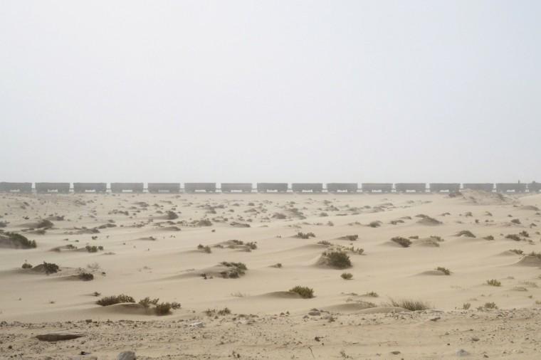 A SNIM train carrying iron ore arrives in Nouadhibou, Mauritania, June 26, 2014. (Joe Penney/Reuters)