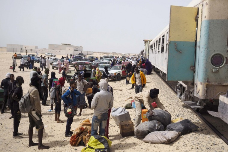 Passengers on a SNIM train carrying iron ore and mine workers arrive in Nouadhibou June 25, 2014. (Joe Penney/Reuters)