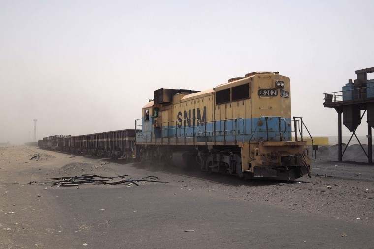 A SNIM freight train moves to collect iron ore at the Guelb mine site in Zouerate June 24, 2014. (Joe Penney/Reuters)