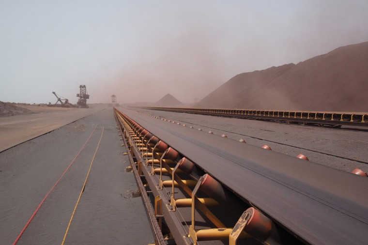 A conveyor belt used to transport iron ore to a ship is seen at SNIM headquarters in the port of Nouadhibou June 26, 2014. (Joe Penney/Reuters)