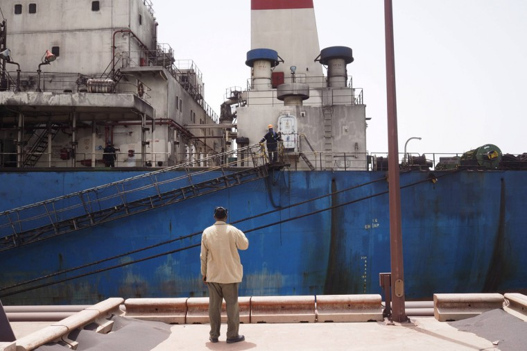 A SNIM security officers speaks to a worker on board a commercial ship carrying iron ore in Nouadhibou June 26, 2014. (Joe Penney/Reuters)
