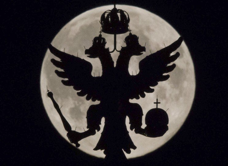 A two-headed eagle, the national symbol of Russia, is seen in front of the supermoon as it rises over the towers of Historical Museum in Moscow August 10, 2014. Occurring when a full moon or new moon coincides with the closest approach the moon makes to the Earth, the Supermoon results in a larger-than-usual appearance of the lunar disk. (Maxim Shemetov/Reuters)