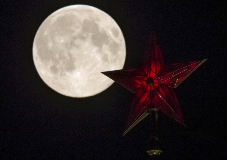 The supermoon rises over the stars of Moscow's Kremlin towers in Moscow August 10, 2014. Occurring when a full moon or new moon coincides with the closest approach the moon makes to the Earth, the Supermoon results in a larger-than-usual appearance of the lunar disk. (Maxim Shemetov/Reuters)