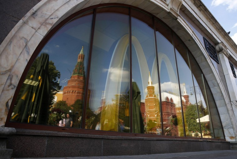 The walls and towers of the Kremlin are reflected in a window of a closed McDonald's restaurant, one of four temporarily closed by the state food safety watchdog, in Moscow, August 21, 2014. Russia ordered the temporary closure of four McDonald's restaurants in Moscow on Wednesday, a decision it said was over sanitary violations but which comes against a backdrop of worsening U.S.-Russian ties over Ukraine. (Maxim Zmeyev/Reuters)