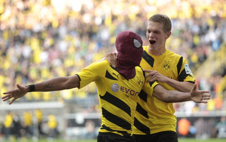 Borussia Dortmund's Pierre-Emerick Aubameyang (with Spiderman mask) and Matthias Ginter celebrate a goal against Bayern Munich during their SuperCup 2014 soccer match in Dortmund . (Ina Fassbender/Reuters)