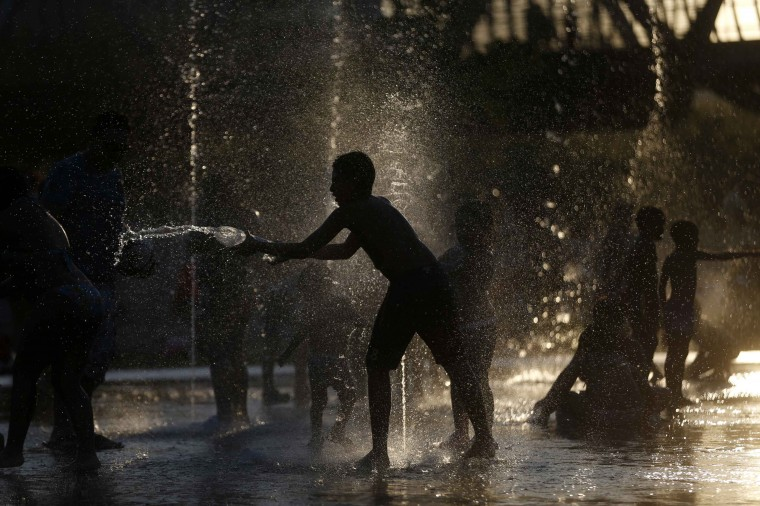 Children play as they cool down in a fountain beside Manzanares river in Madrid August 17, 2014. (Javier Barbancho/Reuters)
