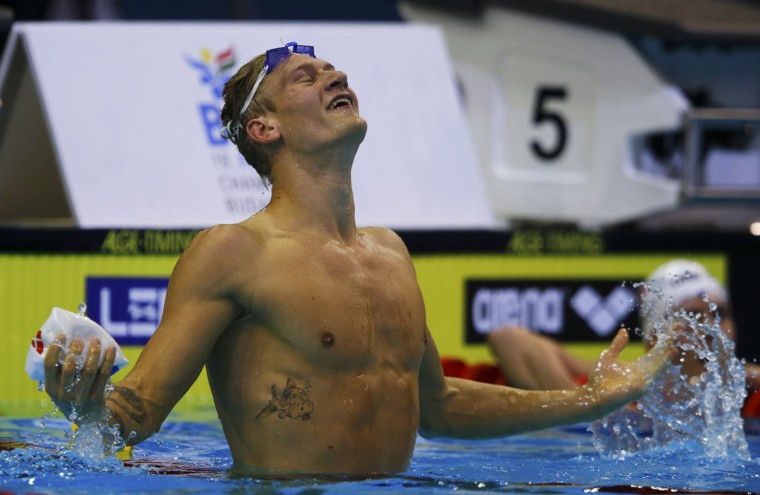 Viktor Bromer of Denmark celebrates victory in the men's 200m butterfly final at the European Swimming Championships in Berlin August 21, 2014. (Michael Dalder/Reuters)