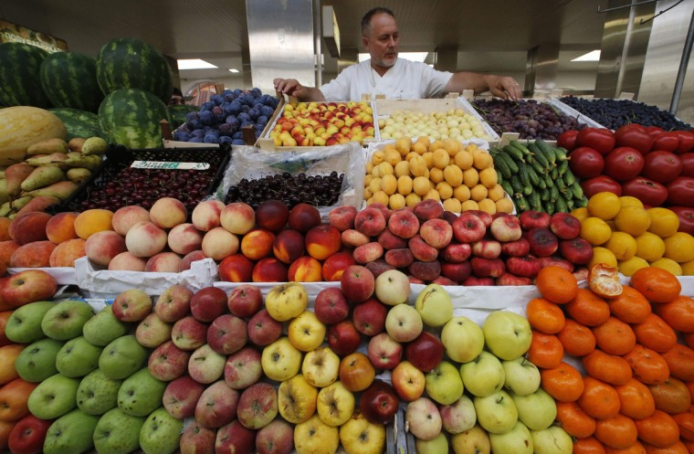 A vendor sells vegetables and fruits at the city market in St.Petersburg August 7, 2014. Moscow imposed a total ban on imports of many Western foods on Thursday in retaliation against sanctions over Ukraine, a stronger than expected measure that isolates Russian consumers from world trade to a degree unseen since Soviet days. (Alexander Demianchuk/Reuters)