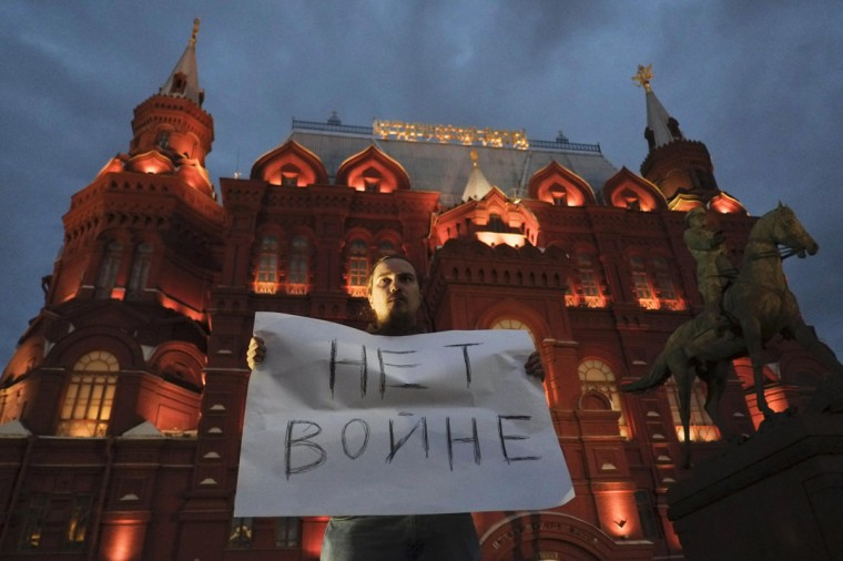 "A man holds a sign during a protest against the conflict in eastern Ukraine in the centre of Moscow August 28, 2014. The sign reads: ""No war"". (Maxim Zmeyev/Reuters)"