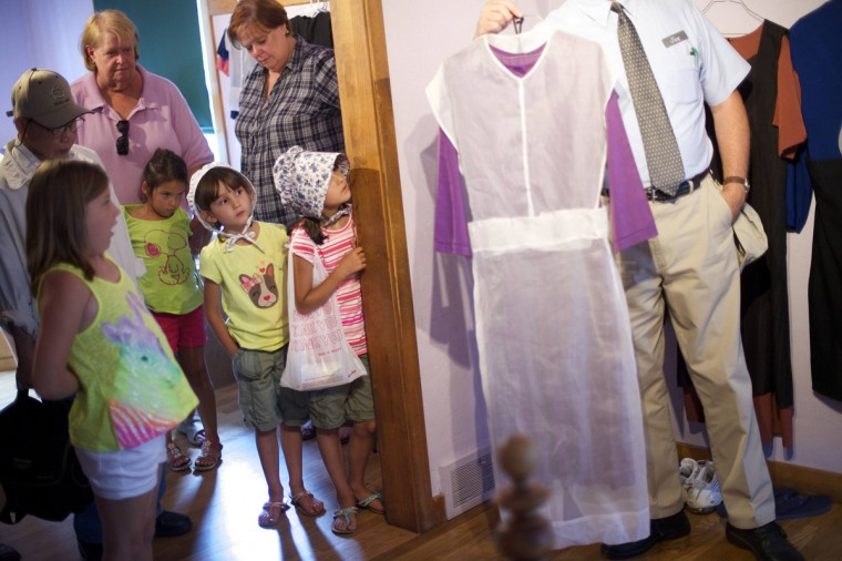 A tour group listens to tour guide Joe Ditzler discuss Amish women's clothing at the Amish Experience, a tourism destination in the village of Bird-in-Hand, Pennsylvania August 9, 2014. (Mark Makela/Reuters)
