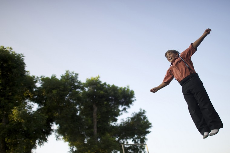 An Amish boy jumps on a trampoline at his home in Lancaster County, Pennsylvania August 9, 2014. (Mark Makela/Reuters)