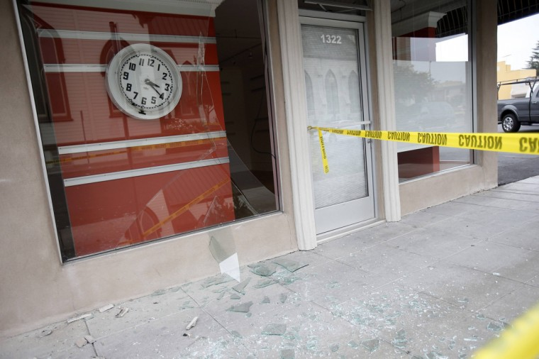A stopped clock is seen in a damaged storefront after an earthquake in Napa, California August 24, 2014. The 6.0 magnitude earthquake rocked wine country north of San Francisco early on Sunday, injuring dozens of people, damaging historic buildings, setting some homes on fire and causing power outages around the picturesque town of Napa. (Stephen Lam/Reuters)