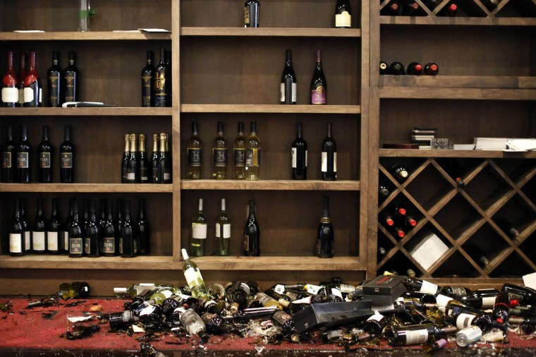 Fallen wine bottles are seen at Cult Following Wine Bar after an earthquake in Napa, California August 24, 2014. The 6.0 earthquake rocked wine county north of San Francisco early Sunday, injuring dozens of people, damaging historical buildings, setting some homes on fire and causing power outages around the picturesque town of Napa. (Stephen Lam/Reuters)