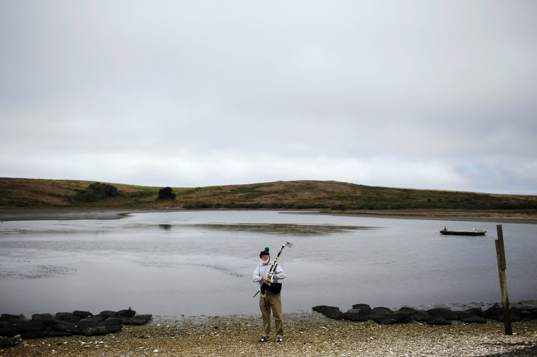 Bagpiper Terry Aleshire prepares to play his bagpipe during a celebration event at Drakes Bay Oyster Company in Inverness, California July 31, 2014. (Stephen Lam/Reuters)